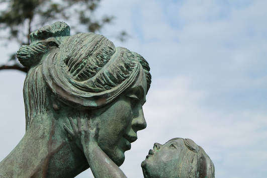 Sculpture of a daughter holding a mother's face